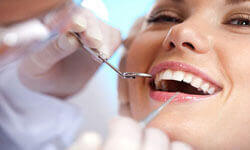 Picture of a smiling woman having a Homeopathy treatment by Premier Holistic Dental in London.